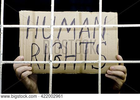 The Concept Of Human Rights Freedom Of Speech Hands Hold A Cardboard Sign With The Inscription Human