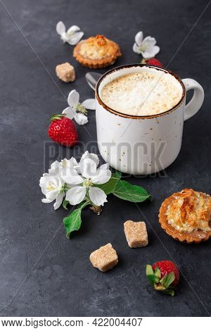 Cup Of Coffee, Cakes And Strawberries On A Wooden Cutting Board On Dark Stone Background. Top View.