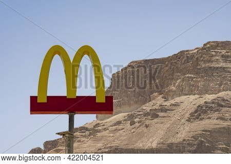 The Dead Sea, Israel - May 20th, 2021: The Mcdonald's Sign Over The Dead Sea Branch (the Lowest Bran