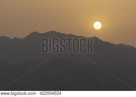 A Hazy Sunrise Over The Edom Mountain Ridges, Jordan, As Viewed From Israel.
