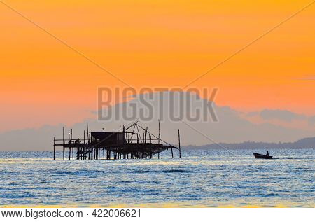 Golden Sunrise Over Sea From Labuan Island,malaysia With Fishingboat,the Mount Kinabalu Sabah And Th