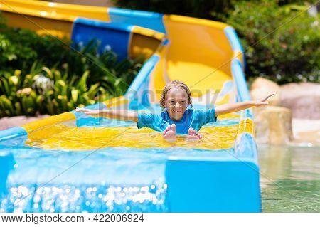 Kids On Water Slide In Aqua Park. Summer Vacation