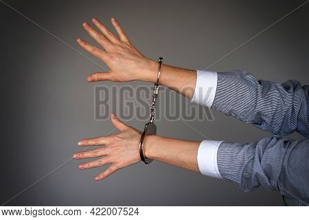 Arrested Woman Handcuffed Hands. Prisoner Or Arrested Terrorist, Close-up Of Hands In Handcuffs Isol