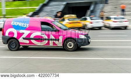 Moscow, Russia - May 2021: Delivery Pink Van Of The Russian Online Store Ozon. Side View Of Car With