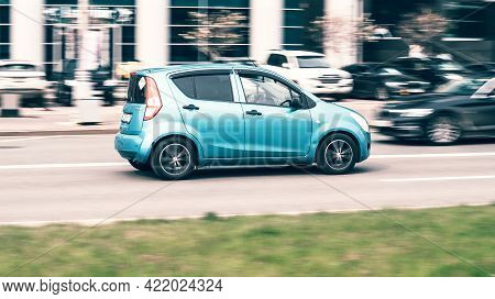 Moscow, Russia - May 2021: View Of A Cyan Suzuki Splash Near Moscow City Business Center