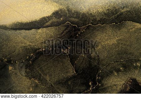 Art Abstract black and gold watercolor painting blots landscape background. Alcohol ink colors. Marble texture.