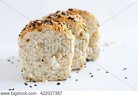 Whole Wheat Bund With White And Black Sesame And Pumpkin Seeds Isolated On White Background