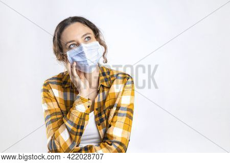 Thoughtful Young Woman Wearing Medical Mask To Prevent Infection Corona Virus