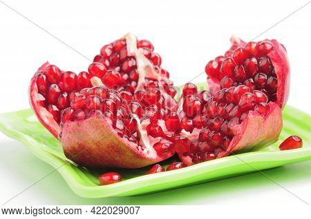 Sliced Pomegranate Wedges On White Background