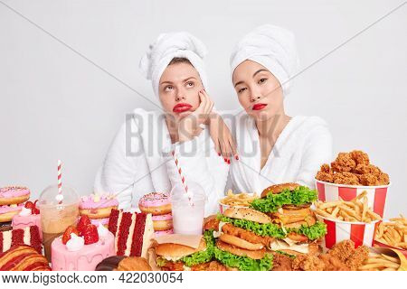 Binge Eating Concept. Sad Bored Women With Clean Skin Red Lips Feel Tired After Eating Too Much Fast