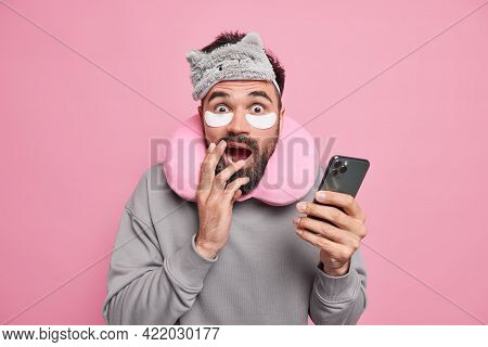 Frightened Bearded Adult Man Looks Terrified At Camera Holds Modern Smartphone Checks News Online Un