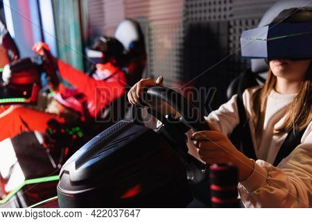 Friends In Vr Headsets Playing Racing Game On Car Simulators, Blurred Foreground.