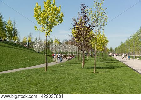 Krasnodar, Russia-may 02, 2021: People Relax And Walk Along The Paths In The Krasnodar Park. The Fre