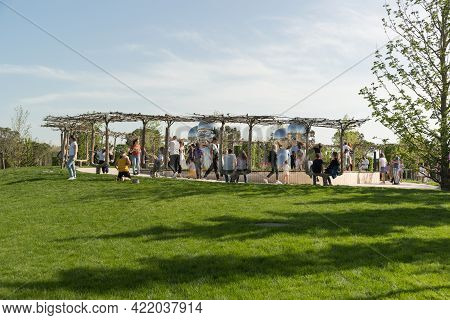 Krasnodar, Russia-may 02, 2021: Many People Walk In A Well-maintained City Park On A Sunny Day