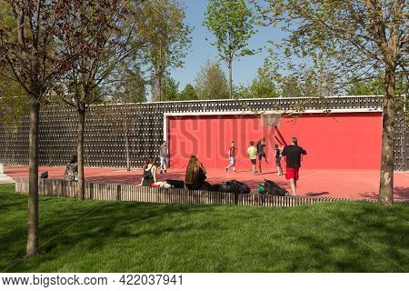 Krasnodar, Russia-may 02, 2021: On A Sunny Day, A Group Of Teenagers Plays Basketball On A Playgroun