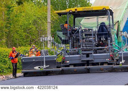 Ukraine, Khmelnytsky Region, Krasyliv. May 2021. Asphalt Paver On The Road During Asphalt Laying. Ro