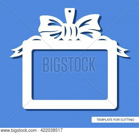 Rectangular Horizontal Photo Frame. Hanging Decoration In The Form Of A Gift With A Bow And Ribbons.