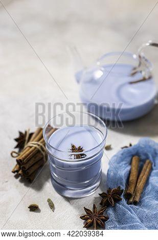 Blue Matcha Latte In Glass On Light Concrete Background. Blue Tea Masala Tea.
