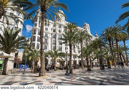 Alicante, Spain - 09 April, 2019: View Of Alley Of Palm Trees, The Main Tourist Street In Alicante,