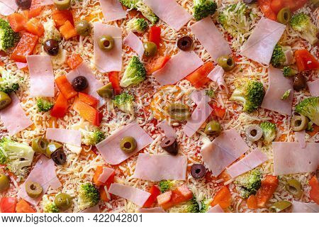 Background Of Raw Homemade Pizza With Ingredients. Uncooked Pizza Close Up Texture Background