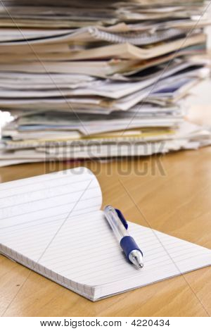Pencil And Notebook On The Table