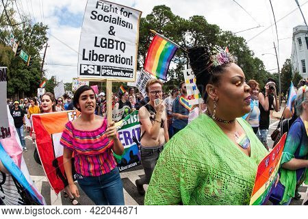 Atlanta, Ga/usa - October 12: People Walk With Signs And Banners Near Piedmont Park, As They Partici