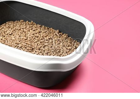 Cat Litter Tray With Filler On Pink Background, Closeup