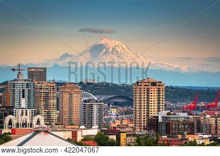 Mt. Rainier viewed from over the skyline of  Seattle, Washington, USA.