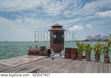 Potted Plants And Incense Burners On The End Of The Unesco World Heritage Site Chew Jetty In The Geo