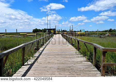 Boardwalk Crossing Over The Marshland At Tybee Island, Georgia.