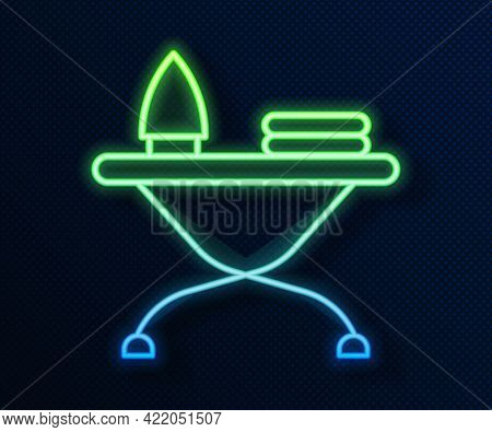Glowing Neon Line Electric Iron And Ironing Board Icon Isolated On Blue Background. Steam Iron. Vect