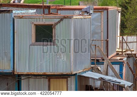 Residential Cabins (a Place For Temporary Residence) Of Builders. They Stand On Top Of Each Other. M