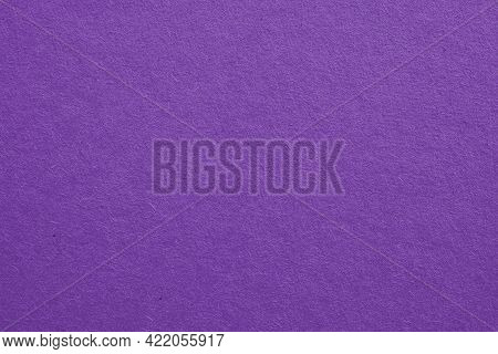 The Surface Of Violet Cardboard. Paper Texture With Cellulose Fibers. Bright Purple Tinted Backgroun