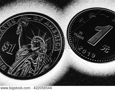 Translation: People's Bank Of China, One Yuan. 1 American Dollar And 1 Chinese Yuan Coins. Black And