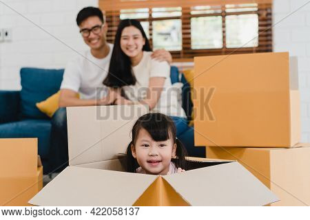 Happy Asian Young Family Homeowners Bought New House. Korean Mom, Dad, And Daughter Playing Together