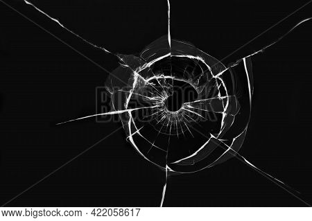 Texture Of Cracks From A Shot On Broken Glass, Abstract Illustration On A Black Background.