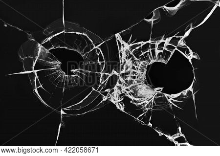 The Effect Of Broken Glass From A Shot. Illustration Of Holes From Pistol Bullets In The Windshield