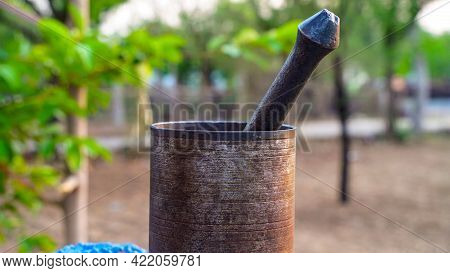 Selective Focus On Pestle And Mortar, The Pestle Is Forged By Hand And The Mortar Cast Iron. Vintage