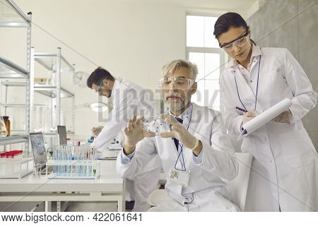 Senior Male Supervisor Make Conclusion Based On Analysis Results Of Test Sample