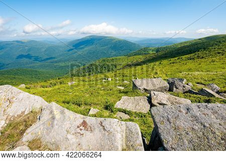 Summer Mountain Landscape. Stones On The Hillside Meadow. Beautiful View In To The Distant Valley On