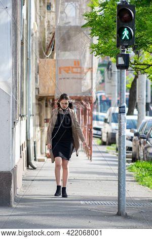 Timisoara, Romania - May 24, 2021: Woman Walking On The Street. Real People.