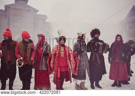Artists And Musicians In Fabulous Costumes At A Street Performance. Kudykina Gora Safari Park. Lipet