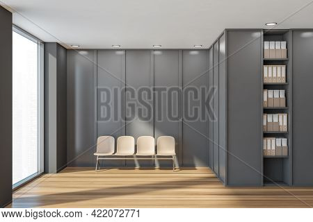Waiting Room Interior With Four Beige Chairs On Parquet Floor, Window With City View. Grey And Woode