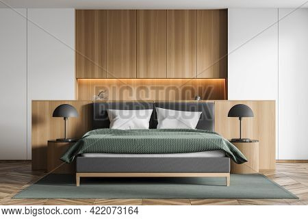 Stylish Modern Interior Of Contemporary Bedroom With Comfortable Furniture. Bed For Two With Blanket