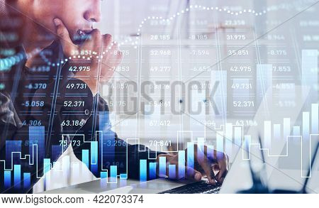 African American Businessman Or Stock Trader Analyzing Stock Graph Chart Using Laptop To Buy Or Sell
