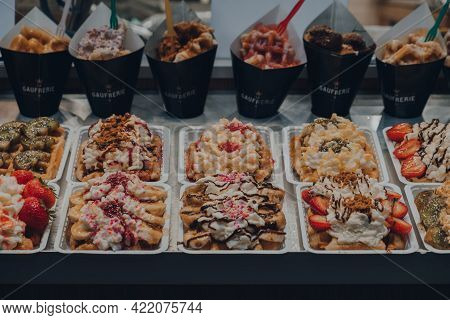 Brussels, Belgium - August 17, 2019: Belgian Waffles With Different Toppings On Sale As A La Gaufrer