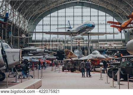 Brussels, Belgium - August 17,2019: People Walk Past Military And Civil Aircrafts Inside Aviation Ha