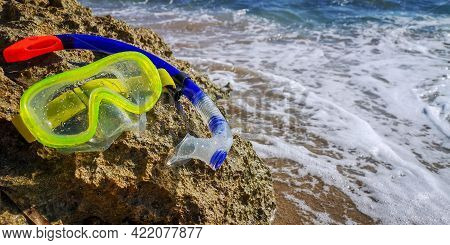 Scuba Diving Equipment. The Swimming Mask On The Sandy Beach. Snorkeling Equipment For Diving