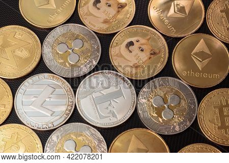 Bitcoins And Altcoins Over Dark Surface In Soft Light
