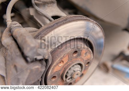 Old Car Brake Disc. The Brakes On The Car Require Regular Maintenance. Very Close-up Of The Brake Di